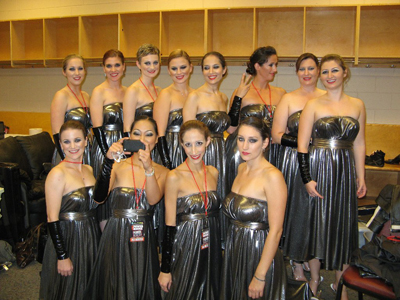 Maria with her fellow musicians backstage before performing with Kanye West